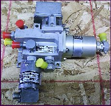 Current operated fuel spill valve